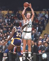 Larry Bird Taking A Shot And Magic Johnson Framed Print