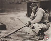 Honus Wagner - In dugout with bats Framed Print