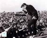 Elvis Presley on stage with fans (#1) Framed Print