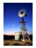 Industrial windmill at night, California, USA Fine Art Print
