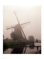 Windmill and Cyclist, Zaanse Schans, Netherlands black and white Fine Art Print