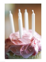 Close-up of a pink frosted cupcake with white unlit candles Fine Art Print