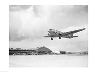Low angle view of a military airplane landing, Douglas DC-3 Framed Print