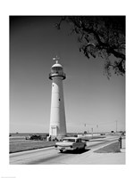 USA, Mississippi, Biloxi, Biloxi Lighthouse with street in the foreground Framed Print