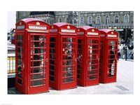 Telephone booths in a row, London, England Framed Print