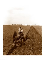 USA, Pennsylvania, Farmer on Tractor Plowing Field Fine Art Print