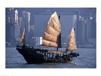 Chinese Junk sailing in the sea, Hong Kong Harbor, Hong Kong, China Framed Print