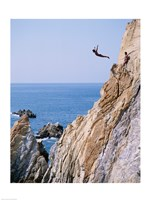 Male cliff diver jumping off a cliff, La Quebrada, Acapulco, Mexico Fine Art Print