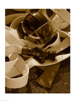 Close-up of a firefighter's helmet on a fire hose Fine Art Print