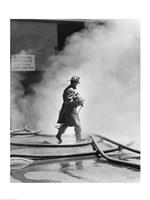 Firefighter walking in front of smoke Fine Art Print