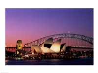 Opera house lit up at night, Sydney Opera House, Sydney Harbor Bridge, Sydney, Australia Framed Print