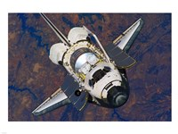 The Space Shuttle Discovery approaches the International Space Station Fine Art Print