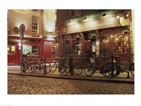 Bicycles parked in front of a restaurant at night, Dublin, Ireland Framed Print