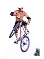 Young man on a bicycle in mid-air Framed Print