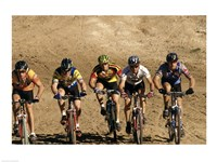 Group of people riding bicycles in a race Framed Print