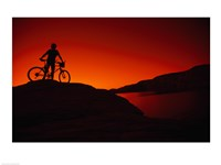 red Silhouette of a man standing with his mountain bike, Lake Powell Framed Print
