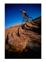 Low angle view of a man mountain biking, Utah, USA Framed Print