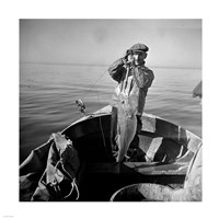 Hauling in a cod aboard a Portuguese fishing dory off Cape Cod, Massachusetts Fine Art Print