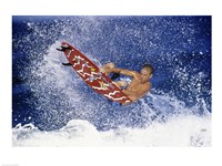 Surfing in action Framed Print