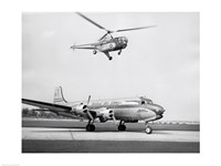 Low angle view of a helicopter in flight and an airplane at an airport, Sikorsky Helicopter, Douglas DC-4 Fine Art Print