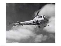 Low angle view of a helicopter in flight in the sky, Bell Helicopter Fine Art Print
