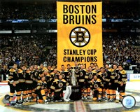 The Boston Bruins raise their 2011 Stanley Cup Chapionship Banner Framed Print