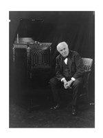 Thomas Edison, seated beside phonograph Fine Art Print