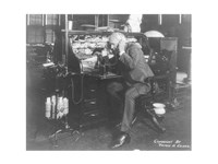 Thomas Alva Edison using his dicatating machine Framed Print