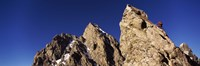 Low angle view of a man climbing up a mountain, Rockchuck Peak, Grand Teton National Park, Wyoming, USA Fine Art Print