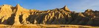 Sculpted sandstone spires in golden light, Saddle Pass Trail, Badlands National Park, South Dakota, USA Fine Art Print