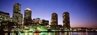 Skyscrapers at the waterfront lit up at night, Boston, Massachusetts, USA Fine Art Print