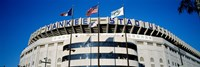 Flags in front of a stadium, Yankee Stadium, New York City Fine Art Print