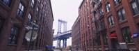 Low angle view of a suspension bridge viewed through buildings, Manhattan Bridge, Brooklyn, New York City, New York State, USA Fine Art Print