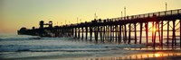Pier in the ocean at sunset, Oceanside, San Diego County, California, USA Framed Print