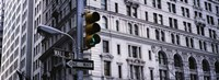 Low angle view of a Green traffic light in front of a building, Wall Street, New York City Fine Art Print