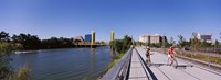 Bicyclists along the Sacramento River with Tower Bridge in background, Sacramento, Sacramento County, California, USA Fine Art Print