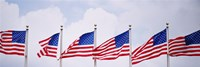 Low angle view of American flags fluttering in wind Fine Art Print