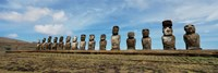 Low angle view of Moai statues in a row, Easter Island, Chile Fine Art Print