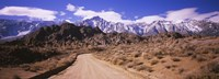 Dirt road passing through an arid landscape, Lone Pine, Californian Sierra Nevada, California, USA Fine Art Print