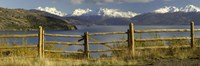 Fence in front of a lake with mountains in the background, Lake General Carrera, Andes, Patagonia, Chile Fine Art Print