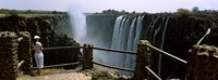 Woman looking at the Victoria Falls from a viewing point, Zambia Fine Art Print