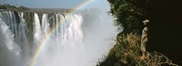 Woman looking at a rainbow over the Victoria Falls, Zimbabwe Fine Art Print
