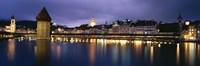 Buildings lit up at dusk, Chapel Bridge, Reuss River, Lucerne, Switzerland Fine Art Print