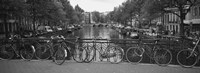 Bicycle Leaning Against A Metal Railing On A Bridge, Amsterdam, Netherlands Framed Print