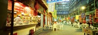 Group of people sitting outside a restaurant, Beijing, China Fine Art Print
