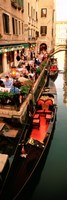 Gondolas moored outside of a cafe, Venice, Italy Fine Art Print