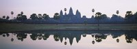 Reflection of temples and palm trees in a lake, Angkor Wat, Cambodia Fine Art Print