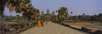 Two monks walking in front of an old temple, Angkor Wat, Siem Reap, Cambodia Fine Art Print