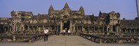 Tourists walking in front of an old temple, Angkor Wat, Siem Reap, Cambodia Fine Art Print