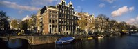 Boats and Buildings along a canal, Amsterdam, Netherlands Fine Art Print